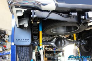 """Rear left underbody shot of the fitted Bilstein 2"""" Shocks with EFS Leaf Springs and U-Bolt Kit"""