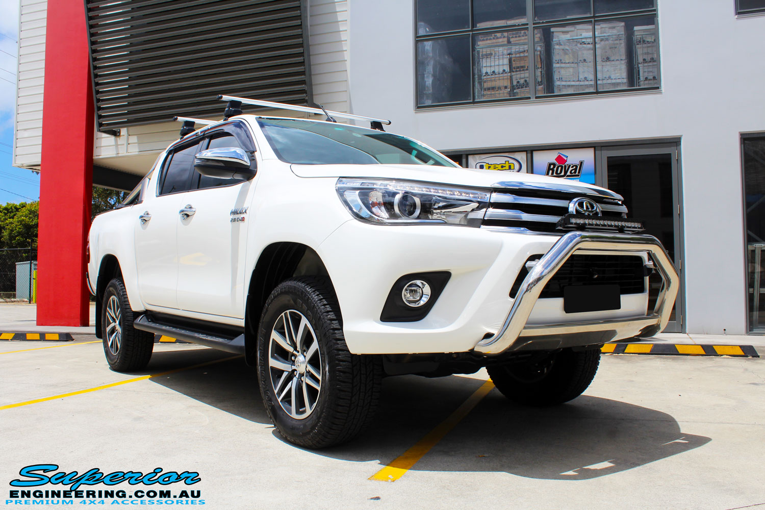 "Right front side view of a White Toyota Revo Hilux Dual Cab after fitment of a Bilstein 2"" Inch Lift Kit"