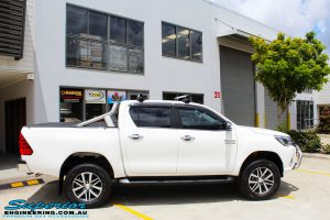 "Right side view of a White Toyota Revo Hilux Dual Cab after fitment of a Bilstein 2"" Inch Lift Kit"