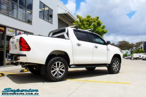 "Rear right view of a White Toyota Revo Hilux Dual Cab after fitment of a Bilstein 2"" Inch Lift Kit"