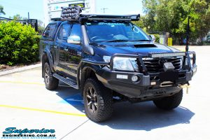 Right front side view of a Black Toyota Vigo Hilux after fitment of Superior Nitro Gas Front Struts, Coil Springs & GME Super Compact UHF CB with Antenna