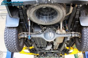 Rear mid underbody shot of the fitted Piggy Back Remote Reservoir Shocks, U-Bolt Kits and Rear Leaf Springs