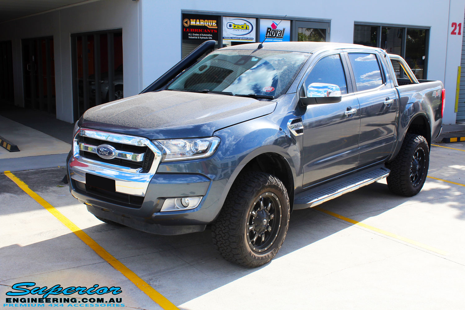"Left front side view of a Ford PXII Ranger in Grey after fitment of a Superior 2"" Inch Remote Reservoir Lift Kit, Rhino 4x4 Evolution 3D Winch Bar + VRS Winch"