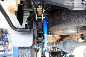 "Rear left underbody shot of the fitted Superior Nitro Gas 2"" Shock + EFS Leaf Spring with U-Bolt Kit"