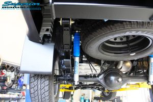 "Rear left underbody view of the fitted Superior Nitro Gas 2"" Shocks + Leaf Spring & U-Bolt Kit"