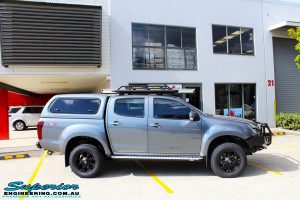 """Right side view of a Grey Isuzu D-Max Dual Cab after fitment of a Superior Nitro Gas 2"""" Inch Lift Kit, MCC Drawer System, MCC 4x4 Bullbar, Hayman Reece Towbar, MCC 4x4 Side Steps, EGR Premium Canopy, Rhino Roof Rack & a Ironman 4x4 Instant Awning with LED's"""