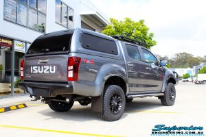 """Rear right view of a Grey Isuzu D-Max Dual Cab after fitment of a Superior Nitro Gas 2"""" Inch Lift Kit, MCC Drawer System, MCC 4x4 Bullbar, Hayman Reece Towbar, MCC 4x4 Side Steps, EGR Premium Canopy, Rhino Roof Rack & a Ironman 4x4 Instant Awning with LED's"""