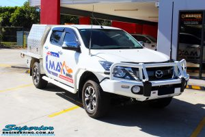 """Right front side view of a White Mazda BT50 Dual Cab before fitment of a Superior 2"""" Inch Remote Reservoir Lift Kit"""