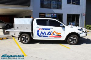 """Right side view of a White Mazda BT50 Dual Cab before fitment of a Superior 2"""" Inch Remote Reservoir Lift Kit"""