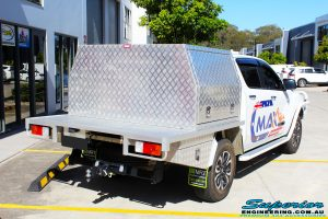 """Rear right view of a White Mazda BT50 Dual Cab before fitment of a Superior 2"""" Inch Remote Reservoir Lift Kit"""