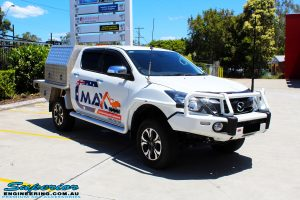 """Right front side view of a White Mazda BT50 Dual Cab after fitment of a Superior 2"""" Inch Remote Reservoir Lift Kit"""