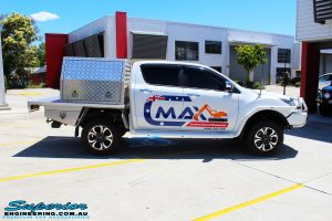 "Right side view of a White Mazda BT50 Dual Cab after fitment of a Superior 2"" Inch Remote Reservoir Lift Kit"