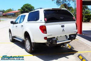"Rear left view of a Mitsubishi MN Triton in White after fitment of a Superior Nitro Gas 2"" Inch Lift Kit"