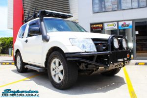 Right front side view of a White Mitsubishi Pajero SWB Wagon before fitment of a range of Superior and various other brands suspension components