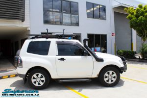Right side view of a White Mitsubishi Pajero SWB Wagon before fitment of a range of Superior and various other brands suspension components