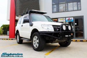 Right front side view of a White Mitsubishi Pajero SWB Wagon after fitment of a range of Superior and various other brands suspension components