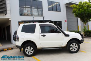 Right side view of a White Mitsubishi Pajero SWB Wagon after fitment of a range of Superior and various other brands suspension components
