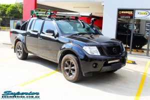 """Right front side view of a Black Nissan D40 Navara Dual Cab before fitment of a Superior Nitro Gas 2"""" Inch Lift Kit + Upper Control Arms"""