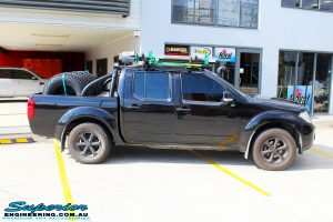 """Right side view of a Black Nissan D40 Navara Dual Cab before fitment of a Superior Nitro Gas 2"""" Inch Lift Kit + Upper Control Arms"""