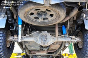 Rear middle underbody view of the fitted Superior Nitro Gas Shocks with Leaf Springs, Extended Shackles & U-Bolt Kit