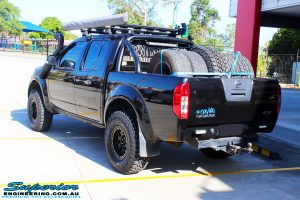 """Rear left view of a Black Nissan D40 Navara Dual Cab after fitment of a Superior Nitro Gas 2"""" Inch Lift Kit + Upper Control Arms"""