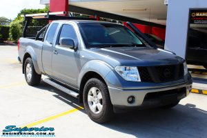 """Right front side view of a Nissan D40 Navara Extra Cab before fitment of a Superior Nitro Gas 2"""" Inch Lift Kit"""