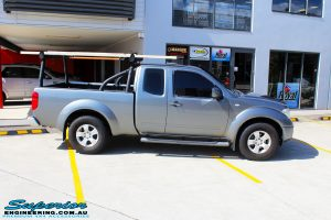 "Right side view of a Nissan D40 Navara Extra Cab before fitment of a Superior Nitro Gas 2"" Inch Lift Kit"