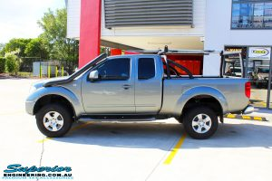 """Left side view of a Nissan D40 Navara Extra Cab after fitment of a Superior Nitro Gas 2"""" Inch Lift Kit"""