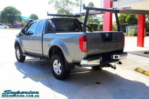 "Rear left view of a Nissan D40 Navara Extra Cab after fitment of a Superior Nitro Gas 2"" Inch Lift Kit"