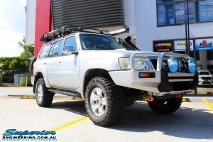 """Right front side view of a Silver Nissan Patrol GU Wagon before fitting a Superior Remote Reservoir Hybrid Dropped Radius 3"""" Inch Lift Kit with Hybrid Radius Arms, Steering Damper, Upper & Lower Control Arms, Comp Spec Draglink, Front & Rear Panhard Rods, Superior Coil Tower Brace Kit, Superior Front Steering Radiator Guard, Body Lift and Airbag Man Coil Helper Ait Kit"""