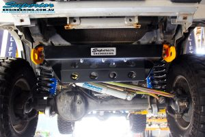 Front on underbody shot of the fitted Superior Radiator Guard, Steering Damper, Comp Spec Draglink and Adjustable Panhard Rod