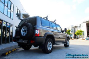 "Rear right side view of a Nissan GU Patrol Wagon before fitment of a Superior Remote Reservoir 2"" Inch Lift Kit"