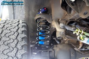 """Front right inside guard shot of the fitted Adjustable Monotube Remote Reservoir 2"""" Shock, Front Remote Reservoir Mounts and Coil Spring"""