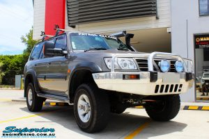 """Front right side view of the Nissan GU Patrol Wagon after fitment of a Superior Remote Reservoir 2"""" Inch Lift Kit"""