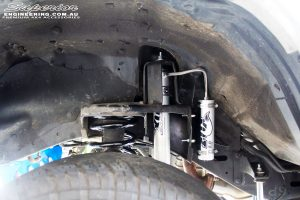 """Front left inside guard view of the fitted Fox 2.0 Performance Series Remote Reservoir 2"""" Inch Shock + Coil Spring"""