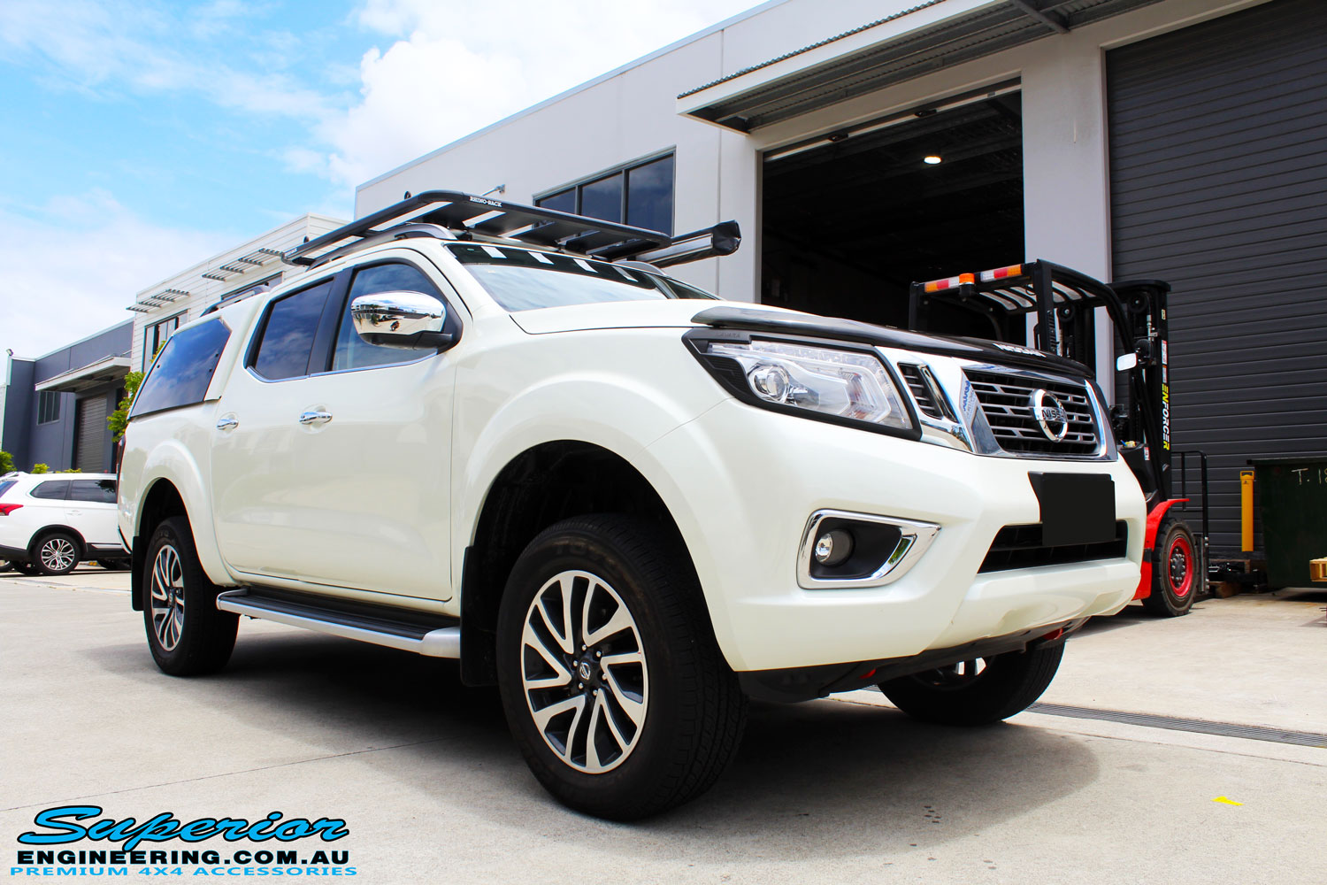 Right front side view of a White Nissan NP300 Navara Wagon before fitment of a range of Superior suspension components