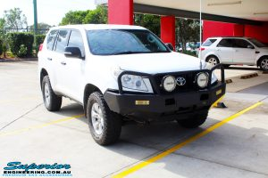 """Right front side view of a White Toyota 150 Landcruiser Prado Wagon before fitment of a Superior Remote Reservoir 2"""" Inch Lift Kit with King Coil Springs and a Ironman 4x4 Snorkel"""