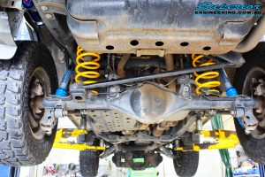 Rear mid underbody view of the fitted Remote Reservoir Shock + King Coil Springs with Airbag Man Coil Air Kit Helper