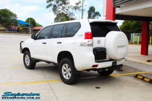 """Rear right view of a White Toyota 150 Landcruiser Prado Wagon after fitment of a Superior Remote Reservoir 2"""" Inch Lift Kit with King Coil Springs and a Ironman 4x4 Snorkel"""