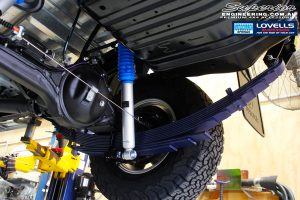 Rear right underbody view of the fitted Rear Leaf Spring + Gas Legend Shock Absorber