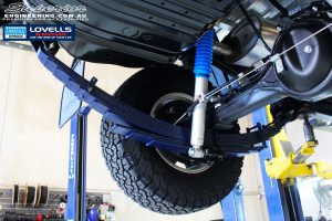 Rear left underbody view of the fitted Rear Leaf Spring + Gas Legend Shock Absorber