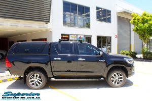 """Right side view of a Toyota Revo Hilux Dual Cab in Black before fitment of a Fox 2.0 Performance Series IFP 2"""" Inch Lift Kit + Upper Control Arms"""