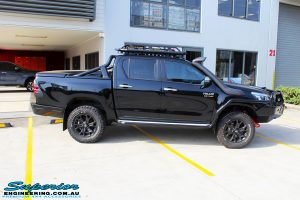 Right side view of a Black Toyota Revo Hilux Dual Cab after fitment of a set of Superior Upper Control Arms & a Wheels & Tyre Package