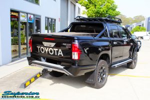 Rear right side view of a Black Toyota Revo Hilux Dual Cab after fitment of a set of Superior Upper Control Arms & a Wheels & Tyre Package
