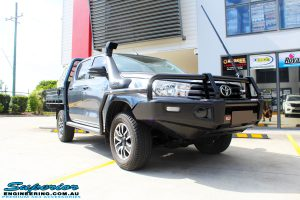 Right front side view of a Grey Toyota Revo Hilux Dual Cab before fitment of Superior Upper Control Arms, Extended Shackles & a Diff Drop Kit