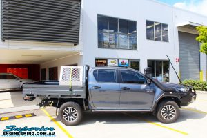 Right side view of a Grey Toyota Revo Hilux Dual Cab before fitment of Superior Upper Control Arms, Extended Shackles & a Diff Drop Kit