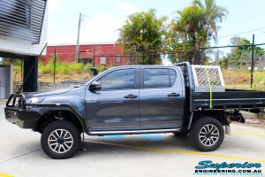Left side view of a Grey Toyota Revo Hilux Dual Cab after fitment of Superior Upper Control Arms, Extended Shackles & a Diff Drop Kit