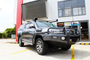 """Right front side view of a Toyota Revo Hilux Dual Cab in Grey before fitment of a Superior Remote Reservoir 3"""" Inch Lift Kit"""