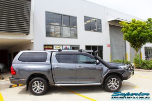 "Right side view of a Toyota Revo Hilux Dual Cab in Grey before fitment of a Superior Remote Reservoir 3"" Inch Lift Kit"