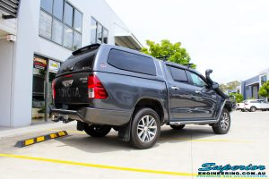 """Rear right view of a Toyota Revo Hilux Dual Cab in Grey before fitment of a Superior Remote Reservoir 3"""" Inch Lift Kit"""